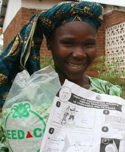 Malawian woman with local seeds